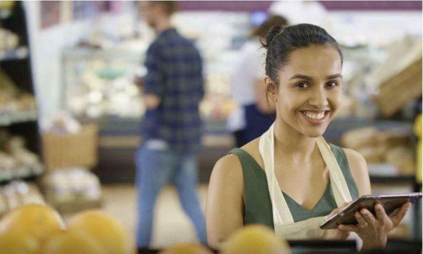 Woman recording store checks in a supermarket